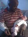 Granddaddy Solomon holding Akilah for the first time