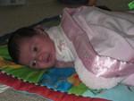 Akilah enjoying tummy time