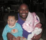 Uncle Omar with nephew Nicholas (2 years) and Akilah (1 week)