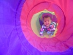 Akilah explores the tent tunnel (6 months)