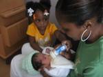 Lynda and Mia feeding Jaynce