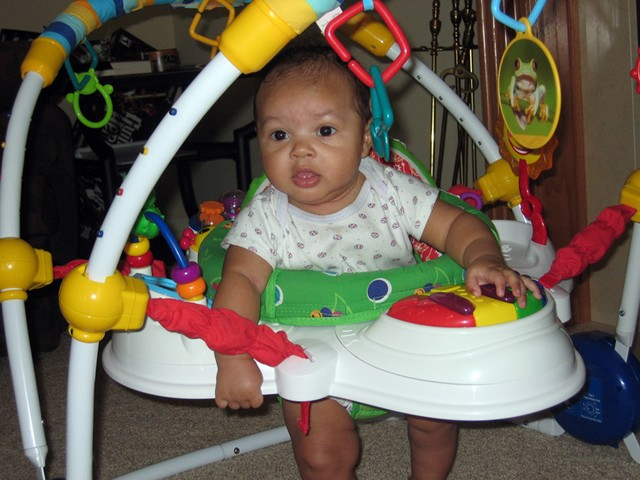 Nicholas in his bouncer playing
