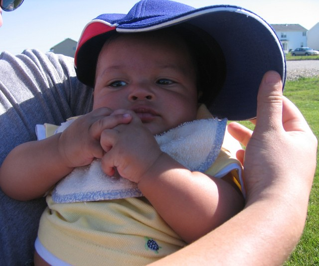 Nicholas getting some shade from Daddy's Cubs hat