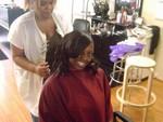 Marcy preparing Rashida's hair