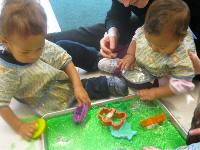 Nate and Akilah playing in jello in Infant2 - january 2011
