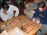 Candice and David working on a 3D puzzle