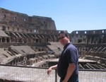 Jason posing in the Roman Colosseum